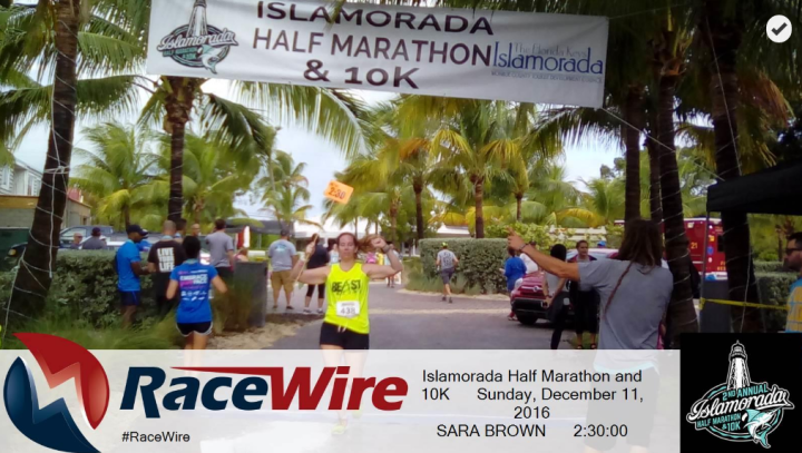 Crossing the finish line of the Islamorada Half-Marathon, which I paced in 2:30. Photo Credit: Race Wire