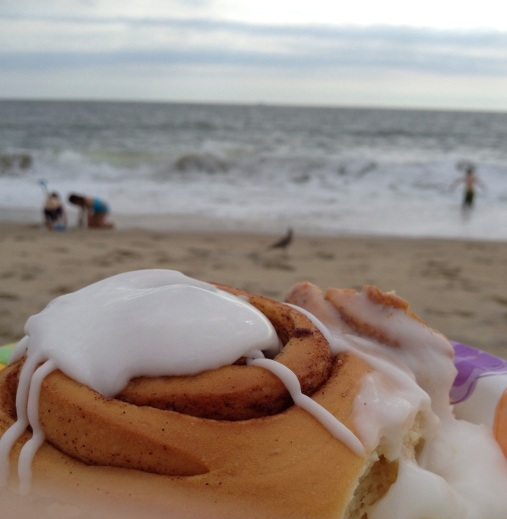 Cinnamon roll and coffee on the beach!