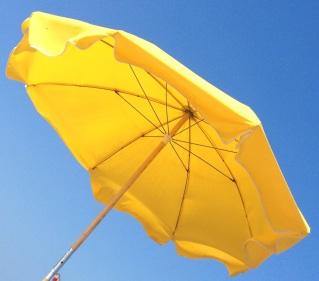 Sunny yellow beach umbrella.
