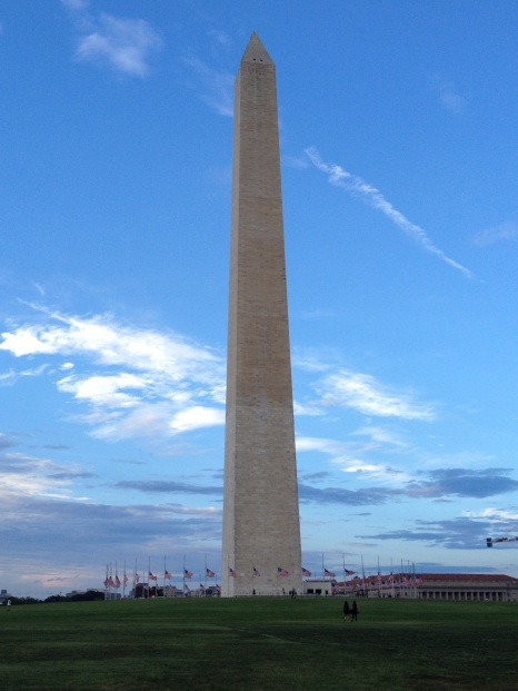 Washington Monument with flags at half-mast