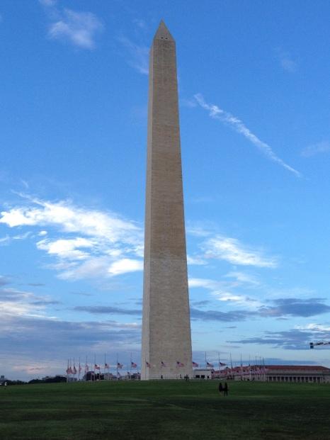 Washington Monument with flags at half-mast