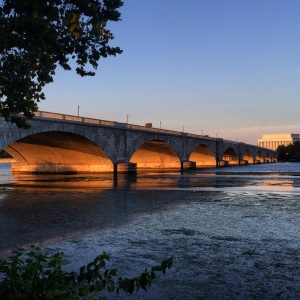 Sunset shining through the Arlington Memorial Bridge.