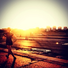 Running along the Arlington Memorial Bridge at sunset