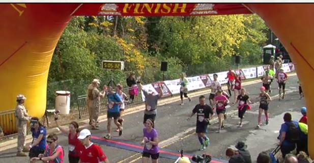 High-fiving the Marines as I finish the 2015 Marine Corps Marathon