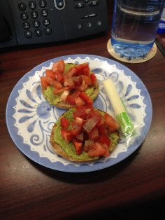 Bagel thins topped with mashed avocado and tomatoes with a cheese stick