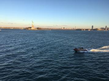 Statue of Liberty and a Coast Guard escort