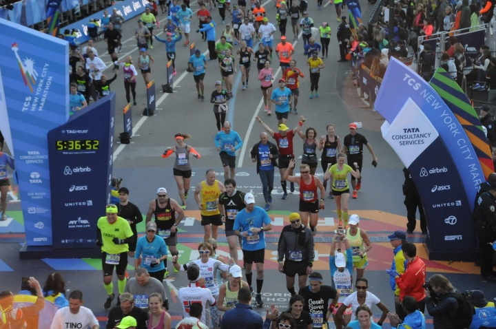 Crossing the finish line. Photo Courtesy: Marathonfoto.com