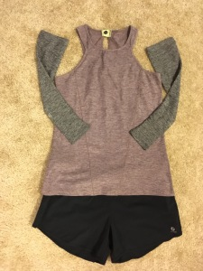 Oiselle Roga shorts in black, OIselle O-Snap tank in burgundy, and Oiselle arm warmers in gray